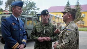 Canadian and Ukrainian servicemen talk during the opening ceremony of a joint military exercises in Lviv, Ukraine, Monday, Sept. 14, 2015. THE CANADIAN PRESS/AP/Pavlo Palamarchuk
