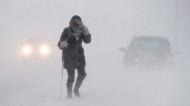 A pedestrian walks down Brunswick Street near Citadel Hill in Halifax as a major winter storm blasts the Maritimes on Monday, Feb. 13, 2017. (Andrew Vaughan/The Canadian Press)