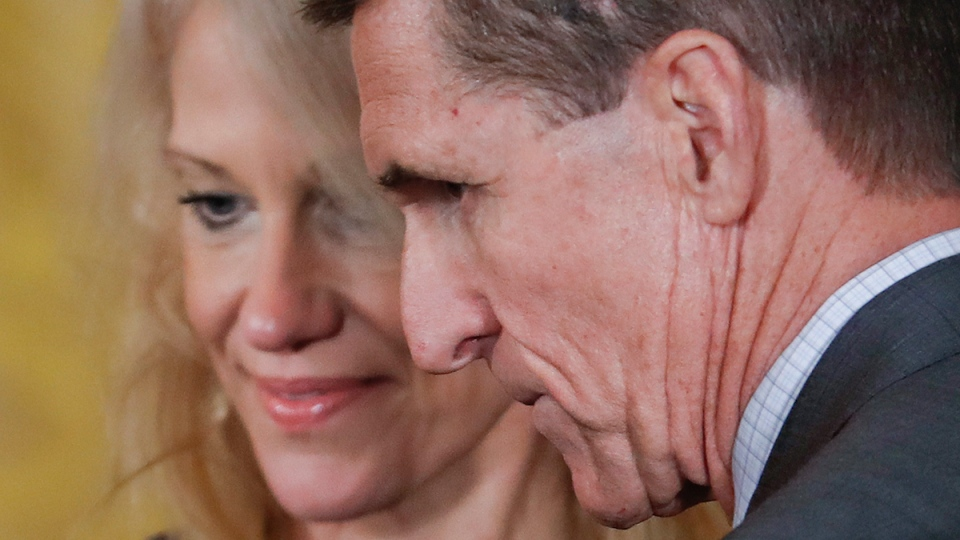 Michael Flynn and Kellyanne Conway in the East Room of the White House in Washington, on Feb. 13, 2017. (Pablo Martinez Monsivais / AP)