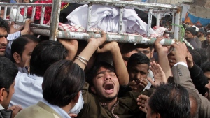 People mourn the death of a family member who was killed in a deadly bomb blast in Lahore, Pakistan. (K.M. Chaudary / AP)