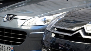 A Peugeot, left, and Citroen cars are parked in Paris, on Sept. 7, 2012. (Jacques Brinon / AP)