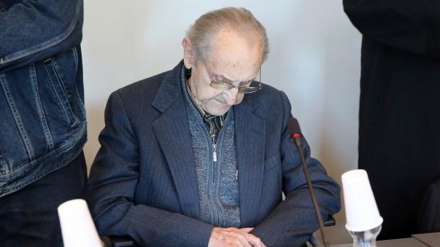 Hubert Zafke sits in a courtroom ahead of his trial in Neubrandenburg, eastern Germany on Sept. 12, 2016. (Bernd Wuestneck/dpa via AP)