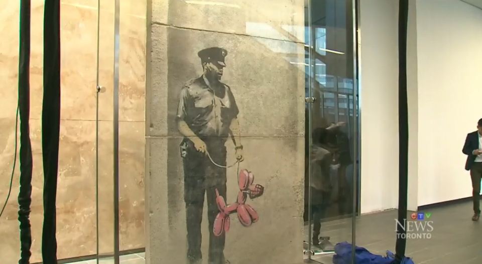 'Police Guard Pink Balloon Dog,' was created by graffiti artist Banksy in Toronto in 2010.