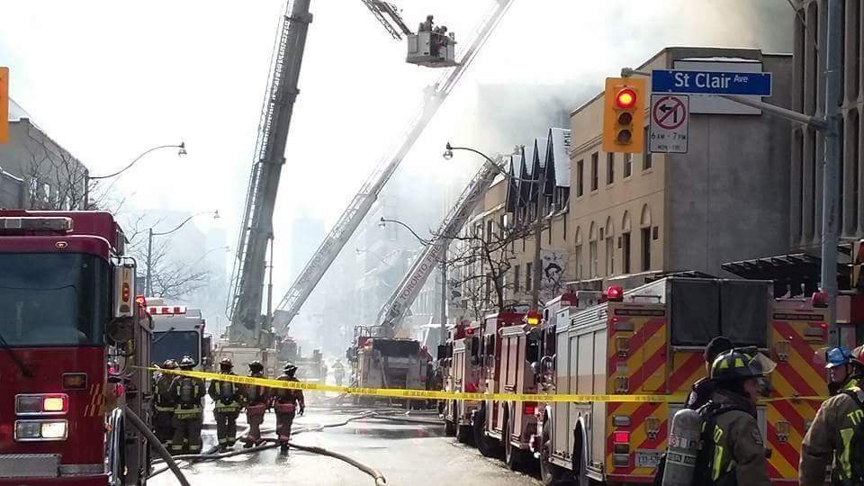 Crews battle a massive fire at on St. Clair in Toronto's Deer Park neighbourhood on Feb. 14, 2017. (Twitter/ Sean Meunier @SeanLuc)