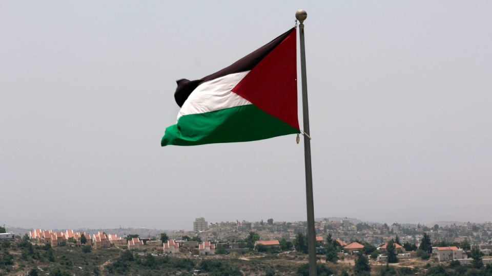 The Palestinian national flag flies from the highest point of the West Bank Palestinian city of Rawabi, north of Ramallah, on June 4, 2016. (Nasser Nasser / AP)