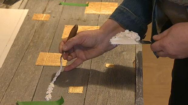 Karen Scarlett, a Calgary artist, creates original works using barn board, plaster and metal.