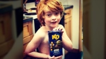 Everett Botwright, 6, is shown with a box of his favourite food, Star Wars-branded Kraft Dinner. (Facebook / Reed Botwright)