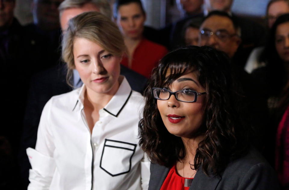 Liberal MP Iqra Khalid makes an announcement about an anti-Islamophobia motion on Parliament Hill while Canadian Heritage Minister Melanie Joly watches on Wednesday, Feb. 15, 2017. (Patrick Doyle / THE CANADIAN PRESS)