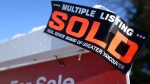 A real estate sold sign is shown outside a house in Vancouver, Tuesday, Jan. 3, 2017. THE CANADIAN PRESS/Jonathan Hayward