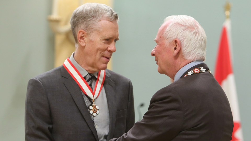 Author and humorist Stuart McLean, of Toronto, is presented with the Officer of the Order of Canada medal by Governor General David Johnston during a ceremony at Rideau Hall, the official residence of the Governor General, in Ottawa on Friday, September 28, 2012. (THE CANADIAN PRESS / Fred Chartrand)