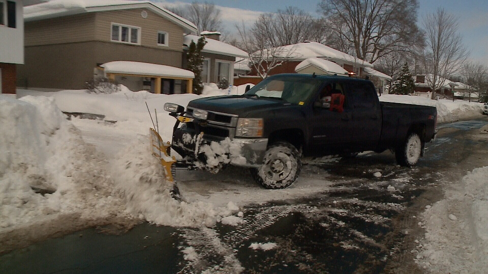 A snowplow removes the snow from a driveway in Nepean on Wednesday. The capital has received 245 cm of snow this winter, five away from most snow removal companies charging more. (Chris Scott/CTV Ottawa, February 15, 2017)