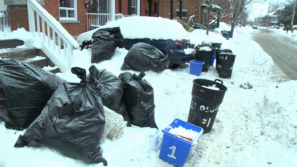 Piles of garbage bags and recycling bins sit atop the snowbanks in Ottawa's Sandy Hill neighbourhood on Wednesday, Feb. 15, 2017.
