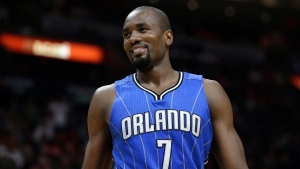 Orlando Magic's Serge Ibaka (7) smiles after being called for a foul during the second half of an NBA basketball game in Miami. The Raptors acquired the veteran power forward Serge Ibaka on Tuesday, Feb. 14, 2017 for Terrence Ross and a 2017 first round draft pick. (AP Photo / Lynne Sladky)