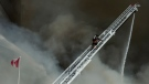 Firefighters battle a six-alarm fire on Yonge St. south of St.Clair Ave. in Toronto on Tuesday, Feb. 14, 2017. (Christopher Katsarov / THE CANADIAN PRESS)