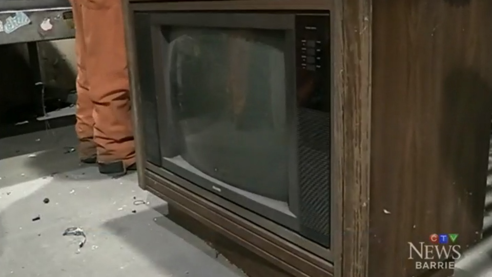 An old television is seen at the Barrie, Ont. recycling plant where in January more than $100,000 was found inside a discarded TV.