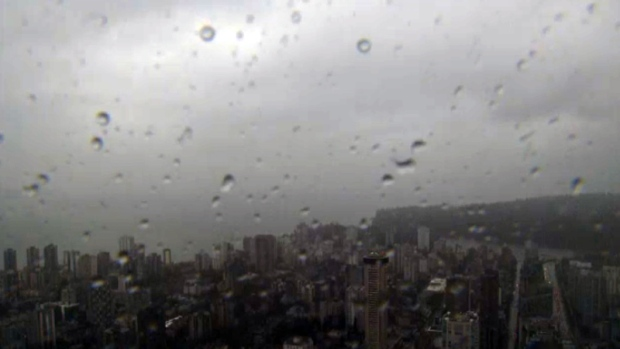 Timelapse: Waves of rain wash over Vancouver