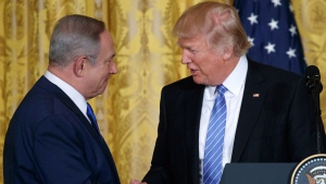 U.S. President Donald Trump shakes hands with Israeli Prime Minister Benjamin Netanyahu during their joint news conference in the East Room of the White House, Wednesday, Feb. 15, 2017, in Washington. (AP Photo/Evan Vucci)