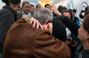 In a Monday, Feb. 6, 2017 file photo, family members who have just arrived from Syria embrace and are greeted by family who live in the United States upon their arrival at John F. Kennedy International Airport in New York. (AP / Craig Ruttle)