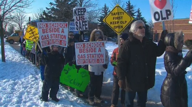 Parents and children gathered outside of Our Lady of Peace Catholic elementary school to protest against its potential closure.