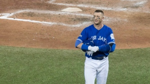 Toronto Blue Jays shortstop Troy Tulowitzki walks back to the dug out after fouling out to Cleveland Indians pitcher Cody Allen to end game five American League Championship Series baseball in Toronto on Wednesday, October 19, 2016. (THE CANADIAN PRESS / Chris Young)