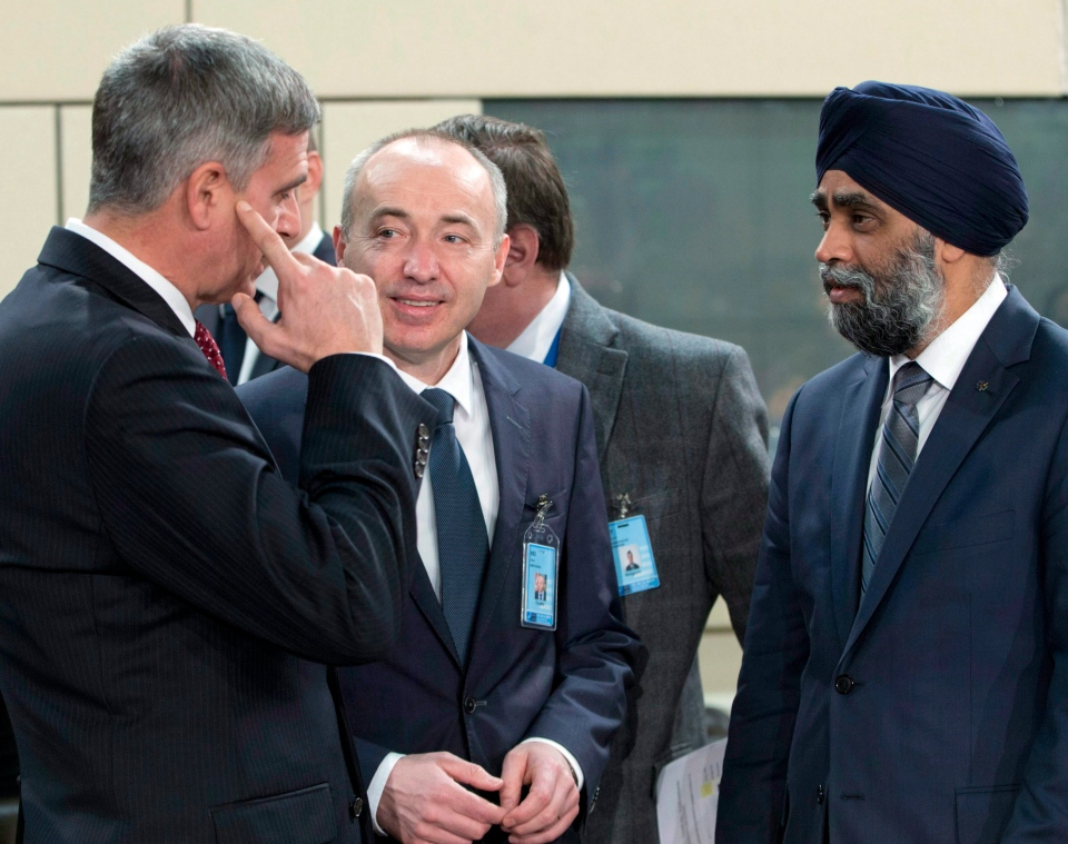 Canadian Defense Minister Harjit Singh Sajjan, right, speaks with Croatian Defense Minister Damir Krsticevic, centre, and Bulgarian Defense Minister Stefan Yanev, left, during a meeting of the North Atlantic Council at NATO headquarters in Brussels on Thursday, Feb. 16, 2017. THE CANADIAN PRESS / AP-Virginia Mayo)
