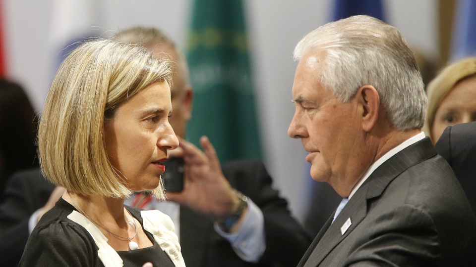Federica Mogherini, High Representative of the European Union for Foreign Affairs and Security Policy, left, and US Secretary of State Rex Tillerson talk to each other during the G 20 Foreign Ministers meeting in Bonn, Germany on Thursday, Feb. 16, 2017. (AP / Michael Probst)