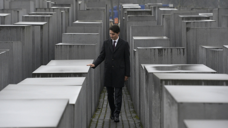 Prime Minister Justin Trudeau participates in a ceremony at the German Holocaust Memorial in Berlin, on Friday, Feb. 17, 2017. (Adrian Wyld / THE CANADIAN PRESS)