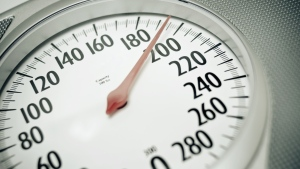 Those who are overweight in their twenties and go on to become obese later in life are more likely to develop cancer of either the esophagus or upper stomach, suggests new research. (Tsuji/Istock.com)