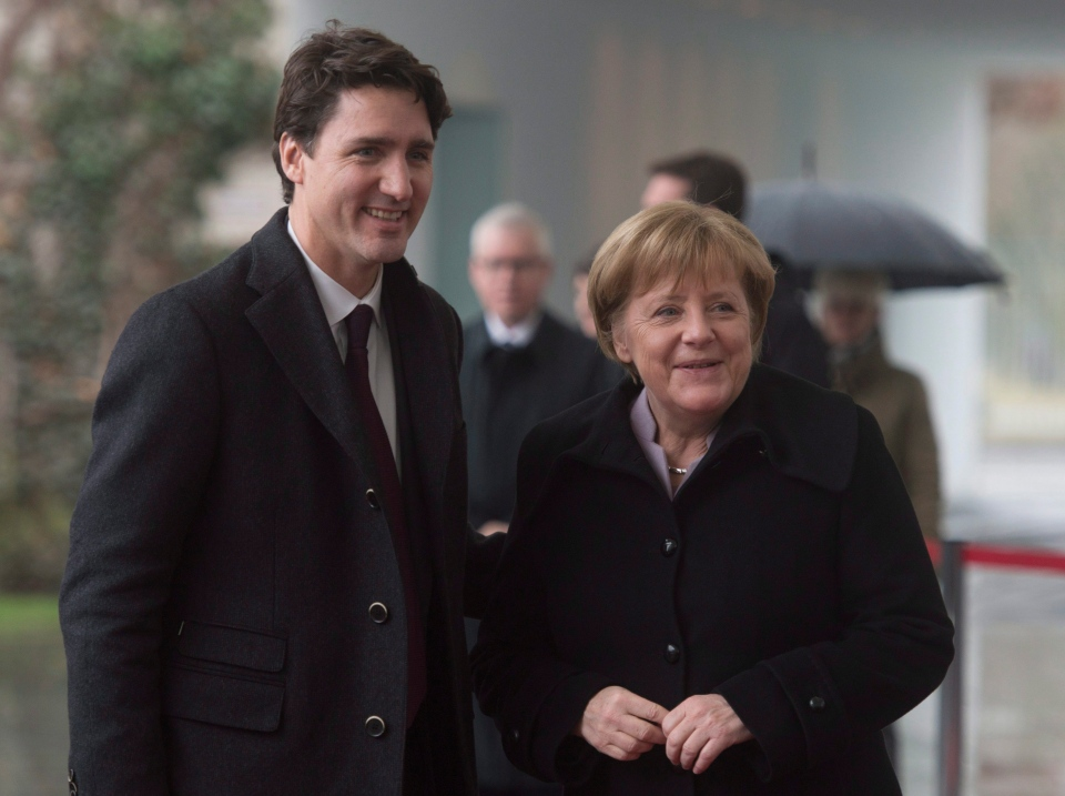 Prime Minister Justin Trudeau speaks with German Chancellor Angela Merkel as he arrives at the Chancellery, in Berlin, on Friday, Feb. 17, 2017. (Adrian Wyld / THE CANADIAN PRESS)