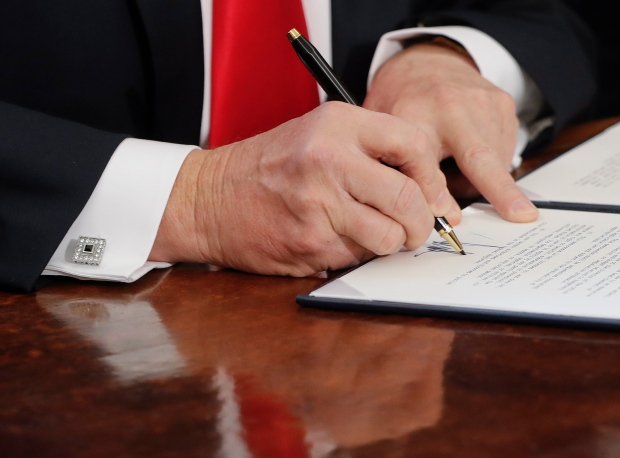 U.S. President Trump signs an executive order