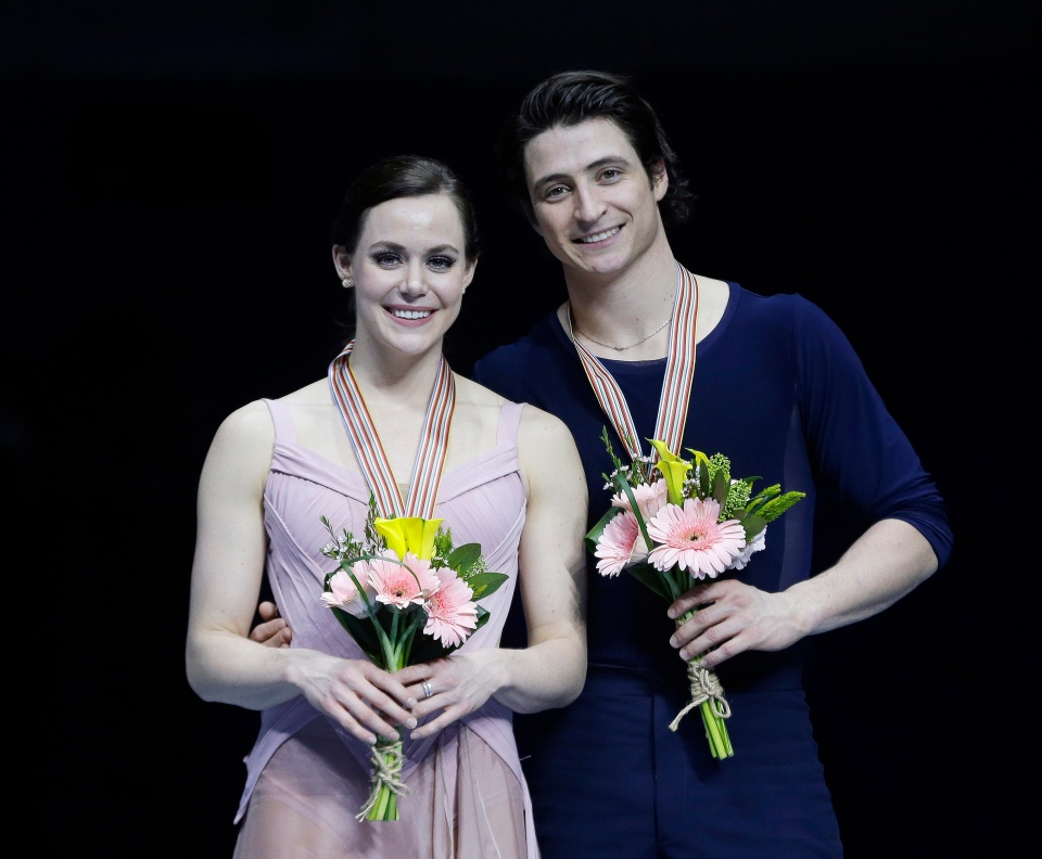 Gold medalists Tessa Virtue and Scott Moir of Canada pose for a photo during the medal award ceremony for the Ice Dance event in the ISU Four Continents Figure Skating Championships in Gangneung, South Korea, Friday, Feb. 17, 2017. (AP Photo/Ahn Young-joon)
