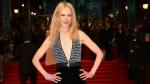 Actress Nicole Kidman poses for photographers upon arrival at the British Academy Film Awards in London, Sunday, Feb. 12, 2017. (Joel Ryan/Invision/AP)