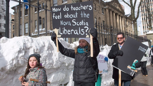 Teachers participate in a one-day, province-wide strike to protest legislation imposing a four-year contract, outside the legislature in Halifax on Friday, Feb. 17, 2017. (THE CANADIAN PRESS/Andrew Vaughan)