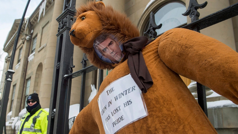 An effigy of Nova Scotia Premier Stephen McNeil is hung outside the legislature in Halifax on Friday, Feb. 17, 2017, as teachers participate in a one-day, provincewide strike to protest legislation imposing a four-year contract. (Andrew Vaughan/The Canadian Press)
