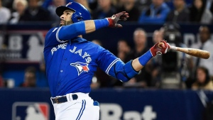 Toronto Blue Jays' Jose Bautista hits a solo home run against the Baltimore Orioles on Oct. 4, 2016. (Nathan Denette/The Canadian Press via AP, File)