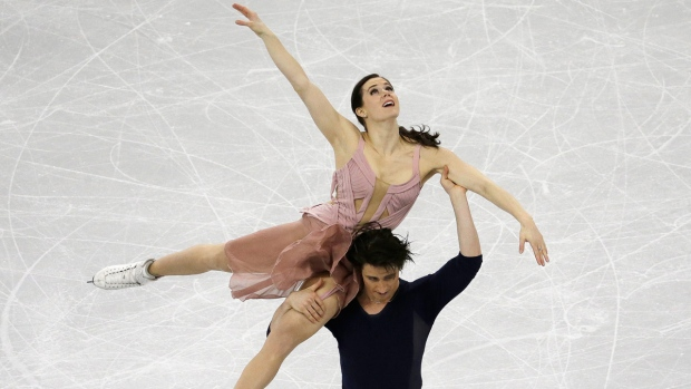 Tessa Virtue and Scott Moir perform
