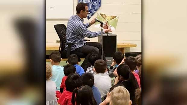 Gord Leclerc cracked a few books with the kids at Principal Sparling School on Feb. 17, 2017.