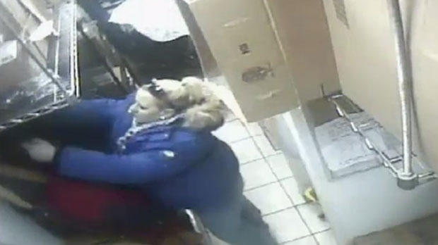 Tim Hortons' surveillance video shows a woman taking property belonging to an employee. (Source: WRPS)