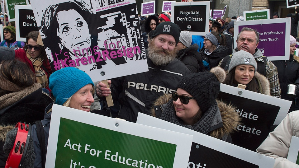 Teachers participate in a one-day, province-wide strike to protest legislation imposing a four-year contract, outside the legislature in Halifax on Friday, Feb. 17, 2017. (Andrew Vaughan / THE CANADIAN PRESS)