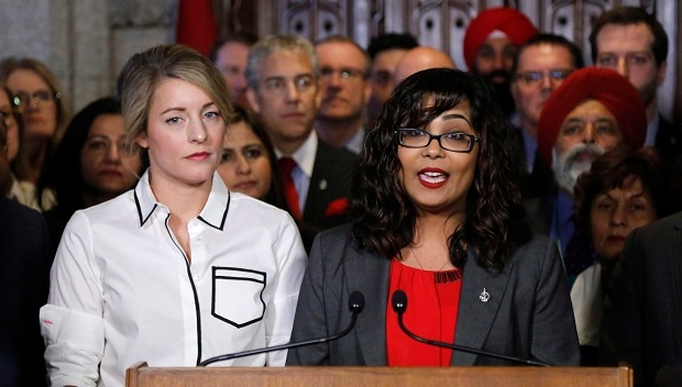 Liberal MP Iqra Khalid makes an announcement about an anti-Islamophobia motion on Parliament Hill while Minister of Canadian Heritage Melanie Joly looks on in Ottawa on Wednesday, February 15, 2017. (THE CANADIAN PRESS/ Patrick Doyle)