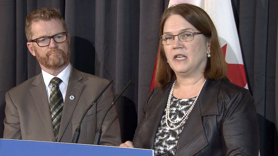 Health Minister Jane Philpott announces a 10-year, $1.4 billion health-funding agreement with B.C. as B.C. Health Minister Terry Lake looks on, in Richmond, B.C., Friday, Feb. 17, 2017.