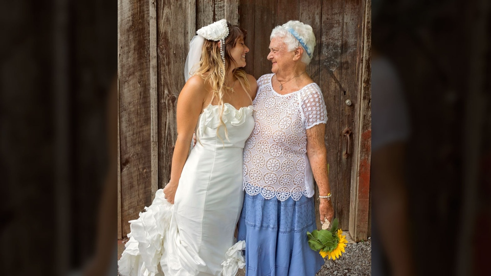 Amanda Scott, left, and her grandmother, May Smith, share a moment on Scott's wedding day on July 31, 2016. (Jeff Jones Photography)