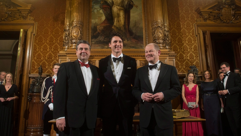 Canadian Prime Minister Justin Trudeau, Hamburg Mayor Olaf Scholz, and German Foreign Minister Sigmar Gabriel, left, pose for photographers after signing the Golden Book at city hall in Hamburg, Germany, on Friday, February 17, 2017. THE CANADIAN PRESS/Adrian Wyld