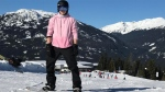 Brooklyn Beckham poses on a snowboard at Whistler in this photo posted to Instagram by his father, David Beckham.