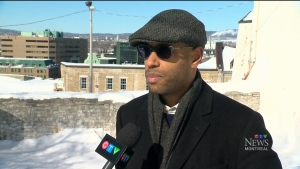 Aly Ndiaye, better known by his stage name Webster, gives walking tours of Quebec