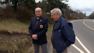 Stephen Donaldson and Mark Perkins helped pull a driver out of a burning car just before flames engulfed the vehicle. Feb. 17, 2017. (CTV Vancouver Island)