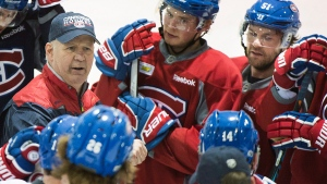 Montreal Canadiens head coach Claude Julien talks with players during practice in Brossard, Que., Friday, February 17, 2017. (Graham Hughes/The Canadian Press)