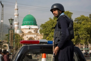 A Pakistani police officer stands guard outside the Barri Imam shrine, as security is beefed up in the capital following a suicide attack at a Sufi shrine in interior Sindh, Islamabad, Pakistan, Friday, Feb. 17, 2017. (AP / B.K. Bangash)