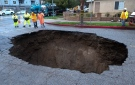 Inspectors examine a sinkhole Saturday, Feb. 18, 2017, in Studio City, north of Los Angeles, Calif. (AP / Ringo H.W. Chiu)