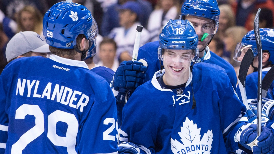 Toronto Maple Leafs' William Nylander, left, congratulates Mitch Marner after their team's 4-1 win over the Boston Bruins following NHL hockey action, in Toronto on Saturday, October 15, 2016. (Chris Young/The Canadian Press)